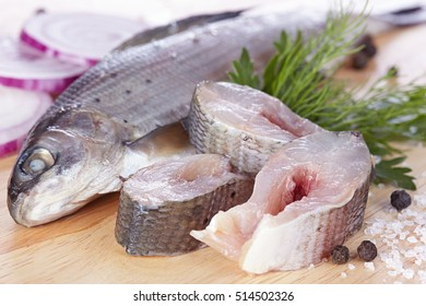 Lightly salted grayling on a chopping board