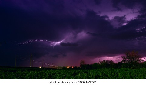 lightning above the railway tracks