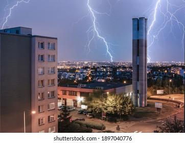 Lightning across the sky in the night city of Prague