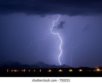 Lightning with airplane hangers in the foreground
