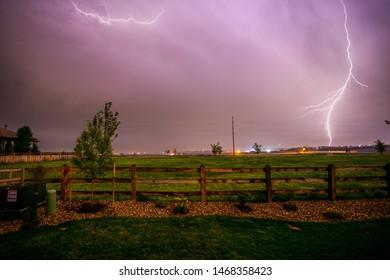 Lightning in the backyard with purple sky