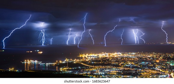 Lightning barrage at cold front passing in Trieste gulf.