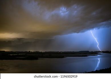 A lightning bolt strikes near a small lake in the vicinity of Rotterdam, Holland.