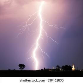 Lightning bolt at strom over village