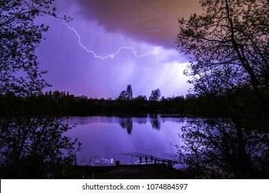 Lightning bolt as summer storm passes over carp fishing lake, Marlow, England, United Kingdon