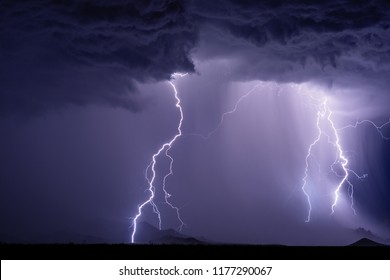 Lightning bolts strike the Dragoon Mountains during a monsoon storm.