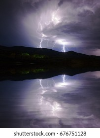 Lightning cracks across the sky in Northern New Mexico over Navajo Lake.