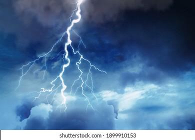 Lightning in dark cloudy sky during thunderstorm