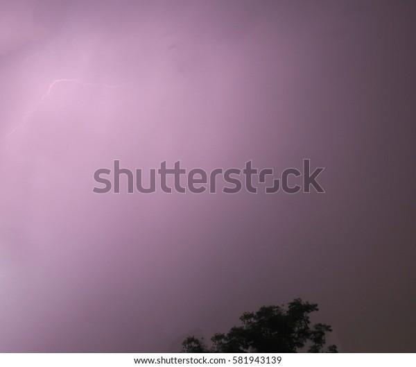 The lightning in the dark sky.