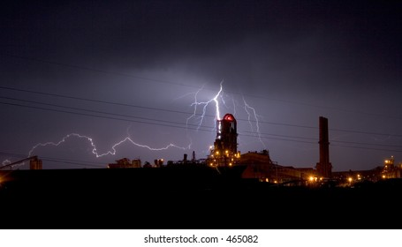 Lightning display over an industrial plant