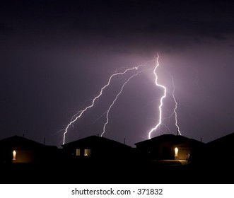 Lightning display over a small community in southwestern United States