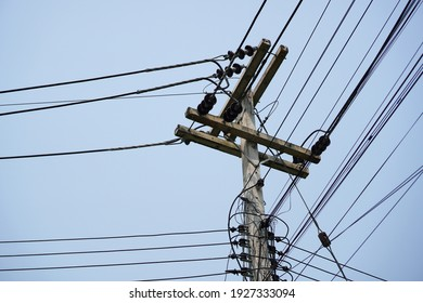 lightning electric pole with unorganized wires. electric high voltage danger. electrical pole silhouette. - Shutterstock ID 1927333094