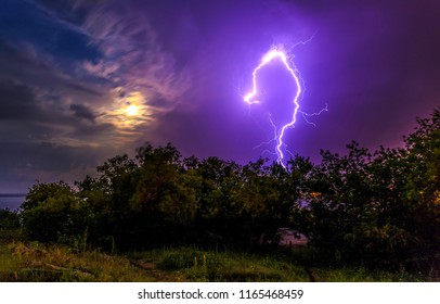 Lightning flash in night stormy sky. Lightning flash strike at night rain storm. Lightning night flash view