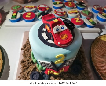 Lightning McQueen Car Model Cake for little 2 years old boy, Disney Pixar Movie Cartoon Characters, Children birthday party, Vientiane, Laos, 1st January 2020. Close up and background image.
