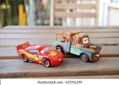 Lightning McQueen and Tow Mater main caracters from the Disney Pixar movie Cars on wooden table on June 2017 in Poznan, Poland. Collection belongs to the toy company Mattel Inc.