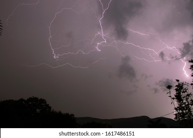 Lightning is a naturally occurring electrostatic discharge in which two electrically charged regions in the atmosphere or ground temporarily equalize themselves.