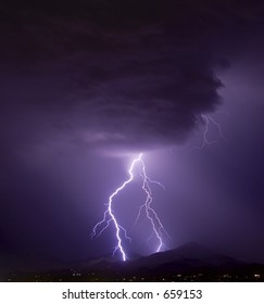 Lightning from an ominous cloud over the desert southwest United States