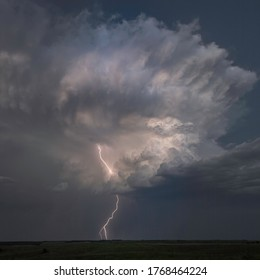 Lightning on the Great Plains with a Supercell background