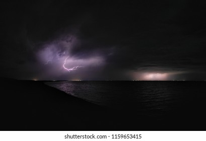 lightning on the lake. storm on the sea. ashore