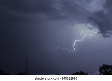 Lightning over Brooklyn rooftops and a radio tower.