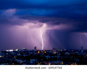 Lightning over Chiang Mai cityscape at night