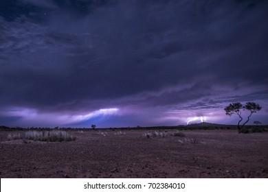 Lightning over desert, three lightnings at the same time, grass desert in Australia, outback