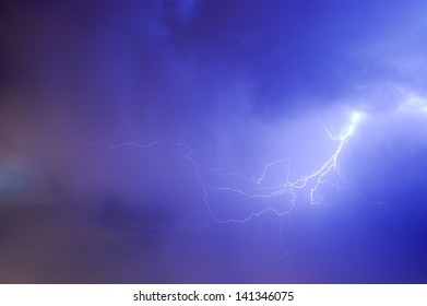 Lightning silhouette on night sky