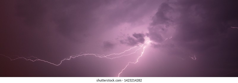 Lightning in the sky at night .