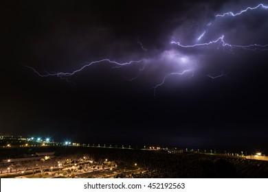Lightning storm over the cemetery and the beach promenade of Nahariya