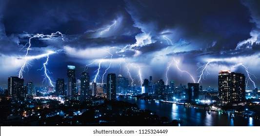 Lightning storm over city in blue light