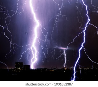 Lightning storm over city, thunderbolt