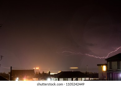Lightning Storm Over Houses at Sandown Bay on the Isle of Wight.