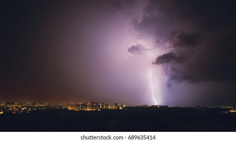 Lightning storm in purple tones in night, panoramic view, copy space