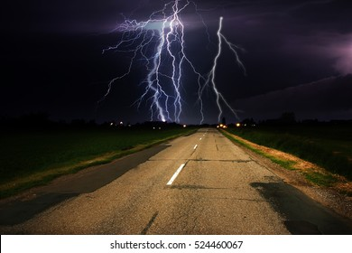 Lightning storm and road
