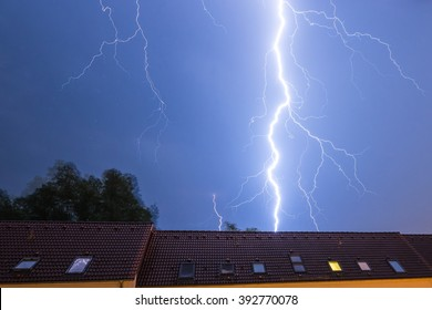 Lightning strike behind a house