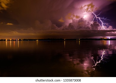 Lightning strike by the water in the sunset