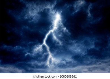 Lightning strike on a cloudy dramatic stormy sky.