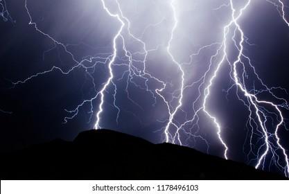 Lightning strike on the dark cloudy sky.  Night thunder-storm