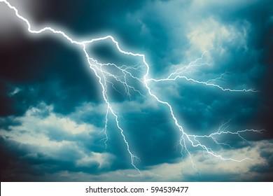 Lightning strike on the dark cloudy sky.