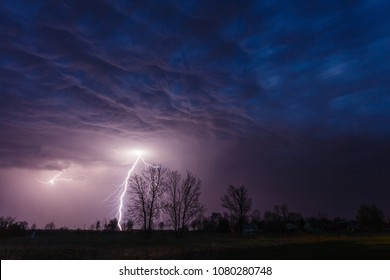 Lightning strike under dramatic sky