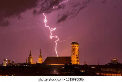 lightning strikes into munich cathedral Frauenkirche while thunderstorm. travel bavaria germany