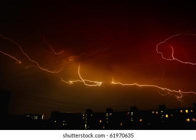 Lightning strikes over dark sky in night city