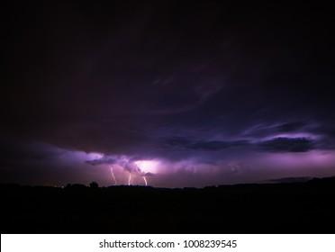 Lightning strikes purple sky