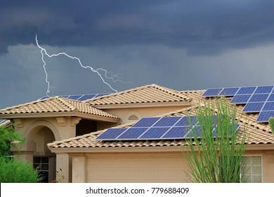 Lightning strikes residential neighborhood house on rooftop solar panels big thunder and lightning storm
