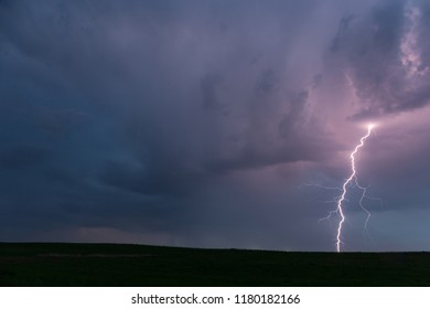 Lightning in the thunderstorm clouds at night