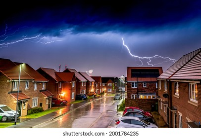 Lightning in a thunderstorm over the town. Lightning in night sky. Lightning over the town street