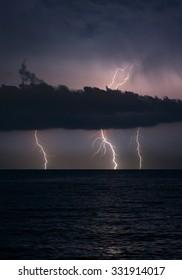 lightnings in dark sky, stormy sea