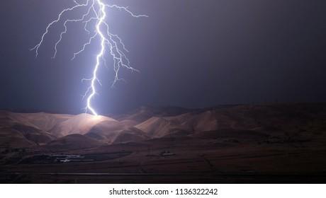 lightnings and thunder bold strike at summer storm. Night long shutter shot