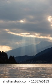 """Lightrays from the sun at the lake """"Weißensee"""" in Carinthia, Austria"""