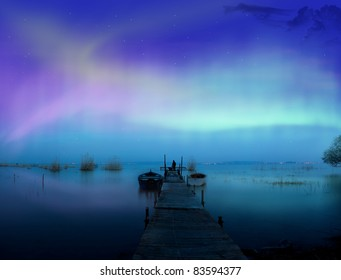 Lights above the lake,man with a dog-Aurora borealis